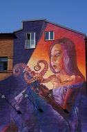Colorful graffiti on a building wall