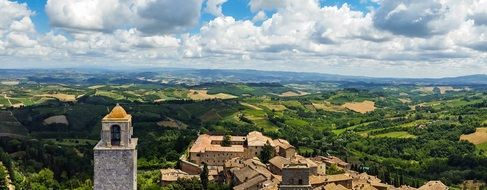 gorgeous panorama of old city at green countryside, italy, tuscany, san gimignano