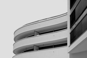 white curved facade, low angle shot