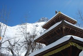 roof of buddhist pagoda at snowy mountain