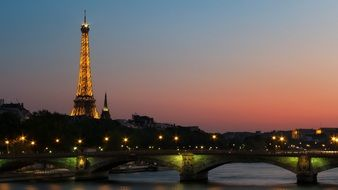eiffel tower at sunset, view from seine river, france, paris