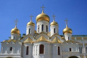 golden domes of Cathedral of the Annunciation at blue sky, russia, moscow