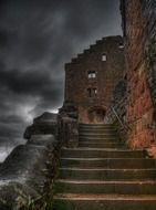 stairway of old ruined castle at cloudy sky, germany