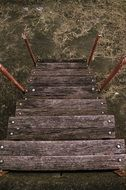 weathered wooden stairs down