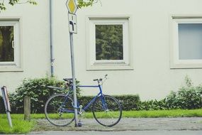 Blue bike near the house