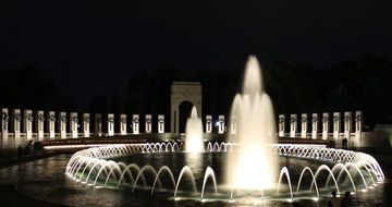 fountains at the WWII memorial at night