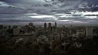 city at dusk under grey clouds, skyline, canada, montreal