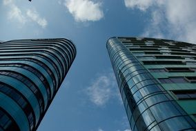 low angle view of two high modern buildings at sky