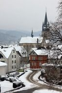 old town with gothic church at mountains, winter landscape
