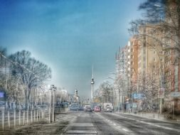 distant tv tower in perspective of street, germany, berlin