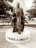 martin luther king with kids, statue in park, usa
