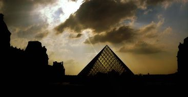 pyramid near the Louvre on a background of clouds
