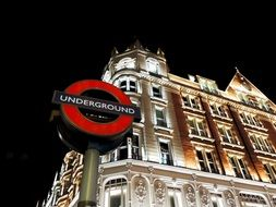 underground street sign at night, uk, england, london, knightsbridge