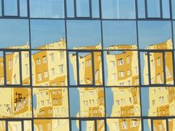 reflection of yellow building on windows