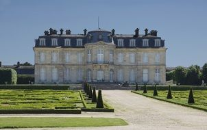 building of Palace of Fontainebleau complex in park, france, seine-et-marne