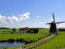 scenic spring countryside landscape with windmill, netherlands