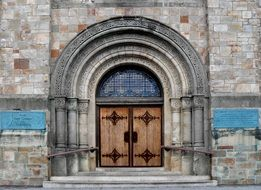 closed church door in ornamented arch, usa, massachusetts, plymouth