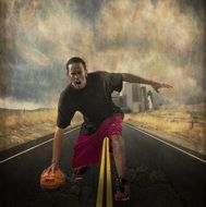 angry basketball player with ball on road in view of city, collage