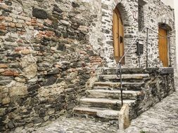 stairs on pavement at entrance door of old stone house, austria, Krems an der Donau