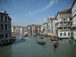 people in gondolas and boats on channel, italy, venice