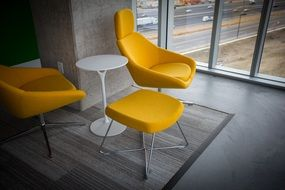 yellow armchairs chairs white table gray floor modern design