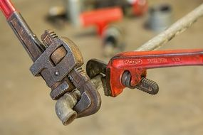 plumbing pipe and wrenches