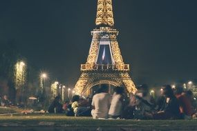 people looking at lightened eiffel tower paris france