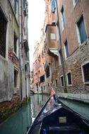 gondola on narrow channel, italy, venice