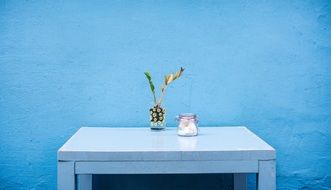 furniture table interior home room blue wall