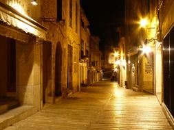 old houses on winding street at night, spain, mallorca