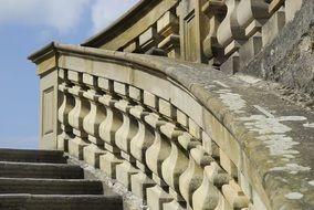old stone stairway with balustrade at sky