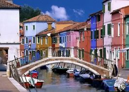 boats on channel at colorful old houses, italy, venice