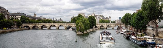 old city panorama with pont neuf bridge across seine river, france, paris