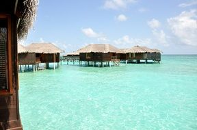 wooden buildings on piles in water, maldives