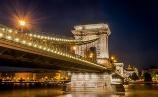 chain bridge above water at night, hungary, budapest