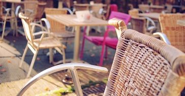wicker furniture on the terrace in a cafe on the street Leiden, the Netherlands