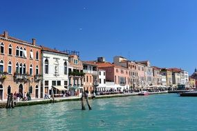 people resting on colorful waterfront, italy, venice