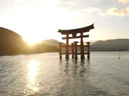 famous torii at Itsukushima Shrine at sunset, japan