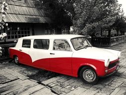 vintage red white car on street