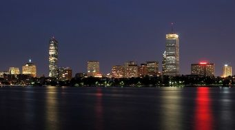 night skyline with colorful reflection on water, usa, massachusetts, boston