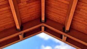 wooden roof at blue sky, bottom view