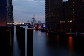 ships in port on elbe river at dusk, germany, hamburg