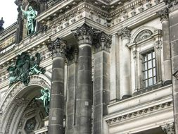 fragment of old facade with columns and sculptures, germany, berlin