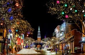 colorful christmas decorations on night street at church, usa, vermont, burlington