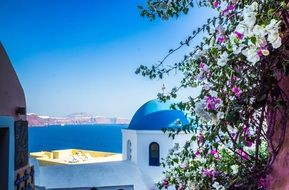 blue dome of small white church at sea, greece, santorini, oia