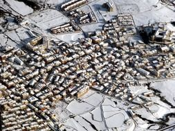 aerial view of old snow covered town, spain