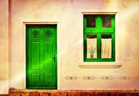 bright green entrance door and window on old house facade