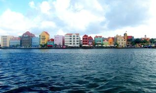 bright painted houses at waterline