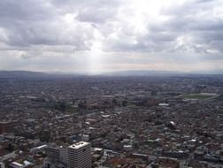 aerial view of city under clouds, colombia, bogota