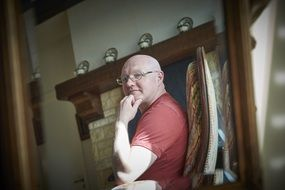 portrait of bald middle aged man at home